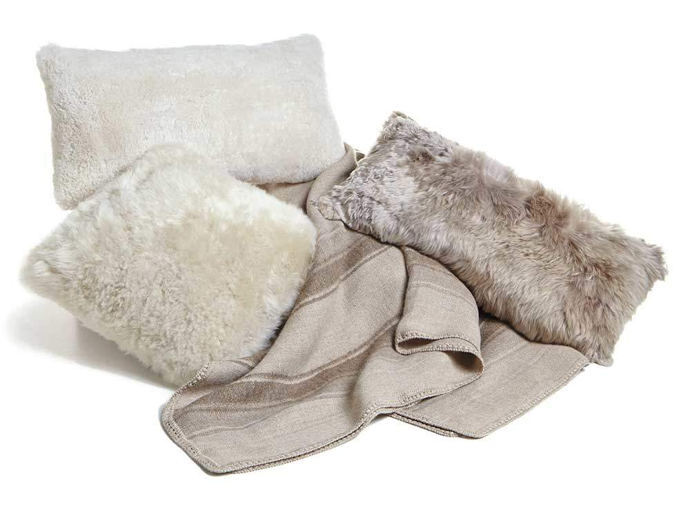 Tan throw pillows and Alpaca Throw